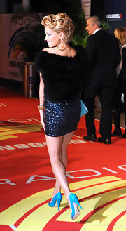 Silvie Van Der Vaart looked ultra glam as she arrived at the Radio Regenbogen Awards in a blue sequin mini dress that was topped off with a fur coat.