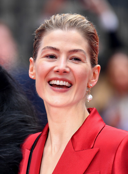 Rosamund Pike brushed her hair back into a casual ponytail for the UK premiere of 'Radioactive.'