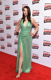 Anya Taylor-Joy sparkled in a mint-green Elie Saab sequin gown with a plunging neckline and a high slit at the Rakuten TV Empire Awards 2018.