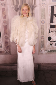 Poppy Delevingne layered a white feather jacket over a satin gown for the Ralph Lauren fashion show.