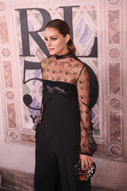 Olivia Palermo paired a floral beaded clutch with a lace-panel jumpsuit for the Ralph Lauren fashion show.