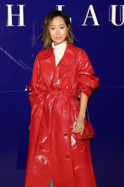 Aimee Song attended the Ralph Lauren fashion show carrying a red chain-strap bag.