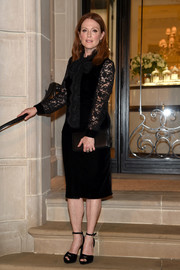 Julianne Moore kept it timeless in a little black velvet dress with lace sleeves at the Ralph Lauren fashion show.