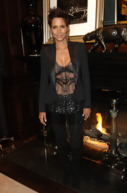 Halle pared down her sexy sheer top with suede knee-high boots.