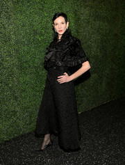 Amy Fine Collins arrived at the screening of 'To Catch a Thief' wearing an elegant black cape over her evening dress.