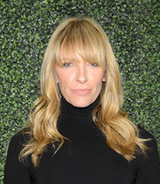 Toni Collette left her wavy hair loose with eye-skimming bangs when she attended the screening of 'To Catch a Thief.'