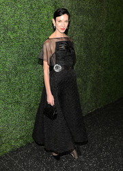 Amy Fine Collins looked oh-so-elegant in a sheer-panel black jacquard dress at the screening of 'To Catch a Thief.'