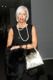 A metallic gold evening purse added major shine to Linda Fargo's look during the screening of 'To Catch a Thief.'