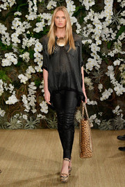 A pair of snakeskin-print platform sandals punctuated Romee Strijd's black outfit.