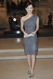 Zhang donned a one-shoulder gray suede cocktail dress for the Vintage Cars Exhibition.