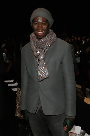 'Miss J' kept both warm and stylish with this multicolored wool scarf at the Ralph Rucci runway show.