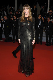 Jennifer Flavin attended the 2019 Cannes Film Festival screening of 'Rambo: Last Blood' wearing an embellished chainmail gown by Ralph Lauren.