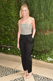 Simple black slacks kept Beth Behrs' look on the casual-chic side.