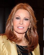 Raquel Welch kept her makeup light and wore pink lipstick at the autograph signing of her book.