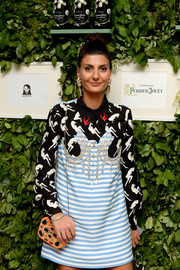 Giovanna Battaglia paired a bejeweled chain-strap bag with a mixed-print shift dress for the Raspoutine Paris Pop-Up event.