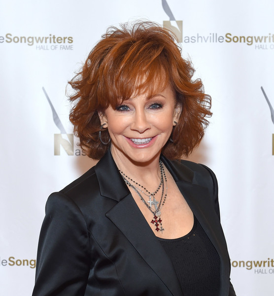 Reba McEntire Short Wavy Cut [hair,hairstyle,human,hair coloring,long hair,layered hair,brown hair,lace wig,suit,white-collar worker,reba mcentire,nashville,tennessee,music city center,nashville songwriters hall of fame,gala,nashville songwriters hall of fame gala]
