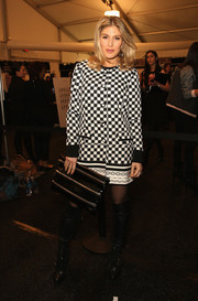 Hofit Golan attended the Rebecca Minkoff fashion show wearing a monochrome coat in a dizzying polka-dot print.