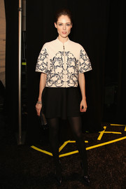 Coco Rocha finished off her outfit in girly style with a flared black mini skirt.