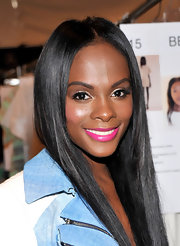 Tika Sumpter sweetened up her look with a swipe of pink lipstick when she attended the Rebecca Minkoff fashion show.