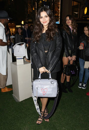 Victoria Justice arrived for the Rebecca Minkoff 'See Now, Buy Now' fashion show rocking an oversized black leather jacket from the brand.