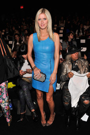 Nicky Hilton cut the monotony with a striped clutch and matching pumps when she attended the Rebecca Minkoff fashion show.