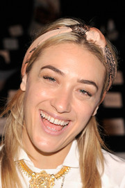 Mia Moretti spruced up her 'do with a printed pink headband when she attended the Rebecca Minkoff fashion show.
