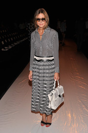 Olivia Palermo donned a busy ensemble, consisting of a patterned long skirt and a houndstooth button-down, at the Rebecca Minkoff fashion show.
