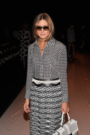 Olivia Palermo experimented with mixed prints at the Rebecca Minkoff fashion show, pairing a black-and-white houndstooth button-down with a patterned long skirt.