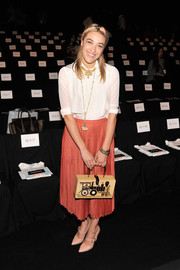 Mia Moretti kept it simple with a pleated coral skirt and a white blouse at the Rebecca Minkoff fashion show.