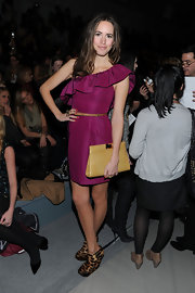 Louise Roe played with neutrals at the Rebecca Taylor Fall 2011 show with a tan leather clutch.