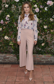 Zoey Deutch opted for a modest long-sleeve floral blouse when she attended the Rebecca Taylor x Shopbop Denim launch.