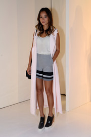 Underneath her vest, Jamie Chung was breezy in monochrome striped shorts.
