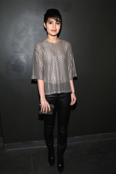 Sami Gayle topped off her ensemble with a metallic clutch with studded circle accents.