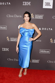 Dua Lipa polished off her elegant look with a pair of bejeweled sandals.