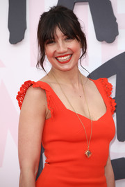Daisy Lowe styled her red frock with a chic gold pendant for the Fashion for Relief Cannes 2018.