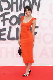 Daisy Lowe was svelte and sexy in a red-orange midi dress with eyelet detailing at the Fashion for Relief Cannes 2018.