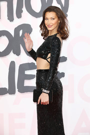 Bella Hadid arrived for the Fashion for Relief Cannes 2018 carrying a simple black box clutch.