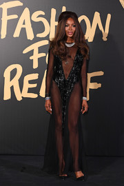 Naomi Campbell sent temperatures soaring with this sheer-panel black gown at the 2019 Fashion for Relief London.