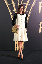 Alexa Chung donned a white  Gucci tweed dress with black vinyl sleeves for the 2019 Fashion for Relief London.