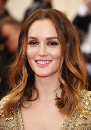 Leighton Meester wore her hair down with a center part and boho waves when she attended the Met Gala.