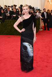 Kirsten Dunst rocked an asymmetrical-neckline Death Star-print gown by Rodarte during the Met Gala.