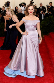 Rashida Jones sported a sweet color combo in a lilac and pastel-blue off-the-shoulder gown by Tory Burch during the Met Gala.