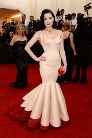 Dita Von Teese cut an incredibly shapely silhouette in a pink and red Zac Posen mermaid gown during the Met Gala.