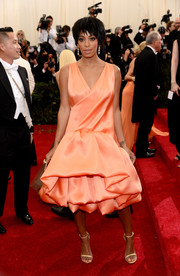 Solange Knowles was quirky-glam at the Met Gala in a sleeveless peach 3.1 Phillip Lim cocktail dress featuring a puffy, tiered skirt.