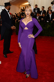 La La Anthony looked va-va-voom at the Met Gala in a curve-hugging purple cutout gown by Cushnie et Ochs.