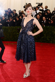 Marion Cotillard looked fun and flirty at the Met Gala in a perforated blue dress by Christian Dior Couture.