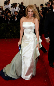 Thalia put her wasp waist on display in a mint-green Tommy Hilfiger corset gown during the Met Gala.