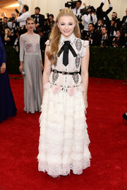 Chloe Grace Moretz was Western-chic at the Met Gala in a white Chanel dress with an embellished bodice, a tiered skirt, and a black tie.