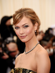 Karlie Kloss wore her hair in a very ladylike chignon during the Met Gala.