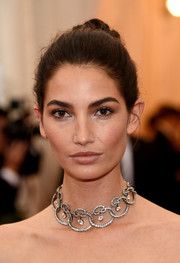 Lily Aldridge completed her elegant look with an intricate diamond choker.